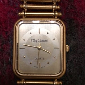 Vintage WORKING Oleg Cassini gold watch